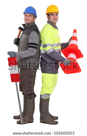 Building workers standing on white background