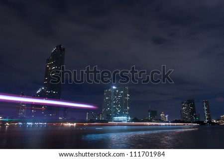 Buildings along the river at night.  The view from Asiatique. Attractions in Bangkok, Thailand.