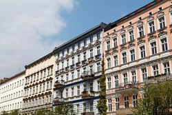 Buildings and blue sky with white clouds in a Berlin street.
