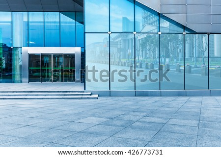 buildings and clean road reflected on the glass wall #426773731