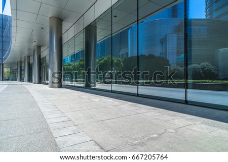 buildings and clean road reflected on the glass wall   #667205764