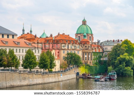 buildings and landmarks of old town, Scenic view on Vltava river and historical center of Prague, Czech Republic. Travel. #1558396787