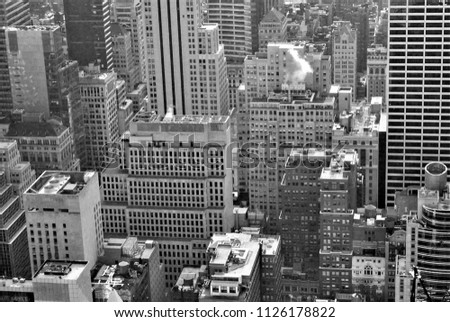 Buildings compete for space in Midtown Manhattan.  #1126178822