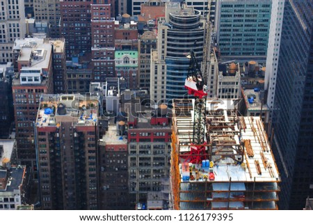 Buildings compete for space in Midtown Manhattan.  #1126179395