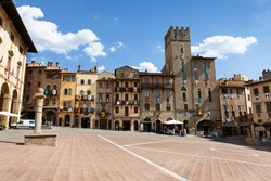 Buildings decorated with coats of arms on Piazza Grande square in Arezzo, Tuscany, Italy