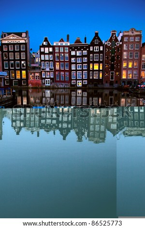 Buildings on canal in Amsterdam #86525773