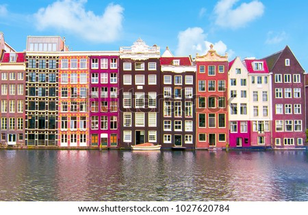 Stock Photo Buildings on Damrak canal, Amsterdam architecture, Netherlands