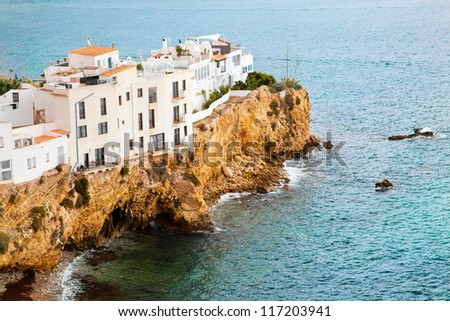 Buildings on the hill by the sea. Ibiza - Eivissa. Spain, Balearic islands - stock photo