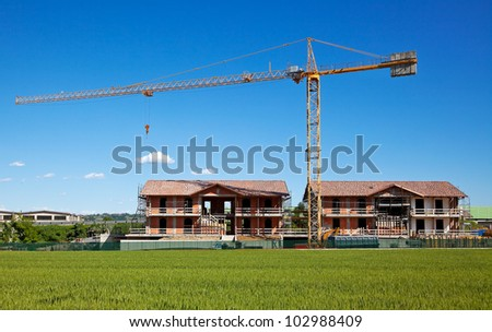 Buildings under construction with crane.