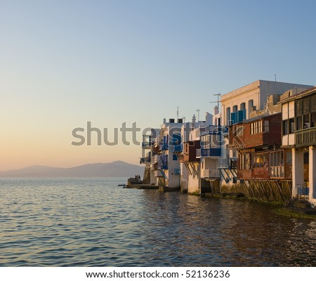 Buildings with balconies at Little Venice on the island of Mykonos in the sunset