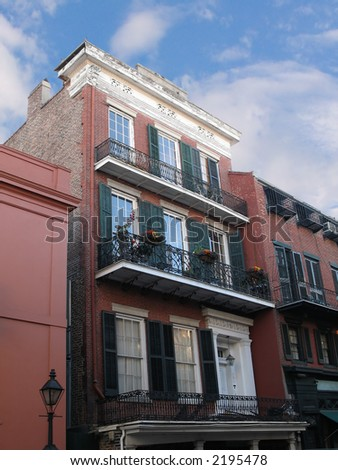 buildings with carved mouldings and iron fretwork in French Quarter, New Orleans, Louisiana