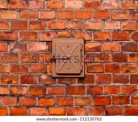 Built-in metal box into a brick wall