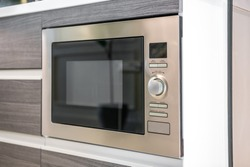 Built-in microwave oven close-up in the kitchen