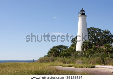 Built in 1831 on the shores of Apalachee Bay, the St. Marks Lighthouse guides boaters to the entrance of the St. Marks River. It is located in St. Marks National Wildlife Refuge in North Florida. - stock photo