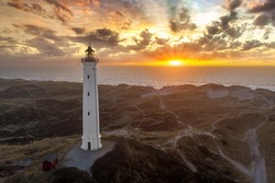 Built in 1906, the 38 meter tall Lyngvig Fyr Lighthouse on the Danish North Sea coast serves as a beautiful tourist attraction amongst the Danish Sand Dunes.