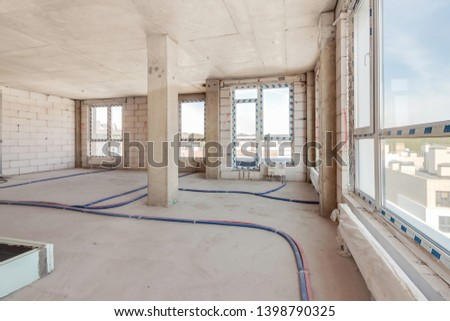 Built structure of residential apartment building interior in progress to new house with large panoramic windows and white brick wall. Empty modern light room under repairing work – Image #1398790325
