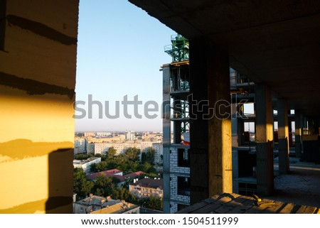 Built structure of residential apartment building interior in progress to new house with white brick wall. Empty modern light room under repairing work #1504511999