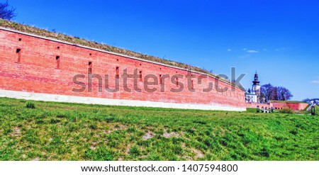 Built structure on field against blue sky. #1407594800