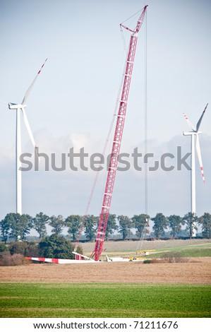 built wind farm with big red crane