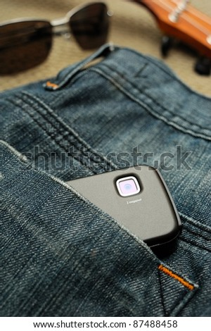 builtin smart phone camera in jeans pocket - stock photo