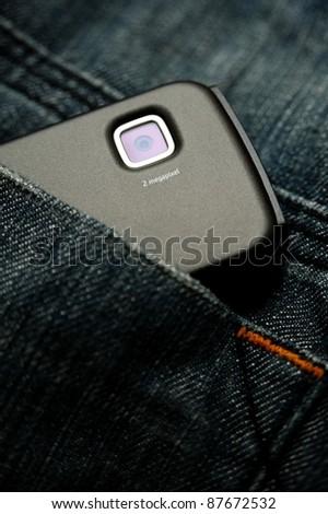 builtin smart phone camera in jeans pocket - stock photo