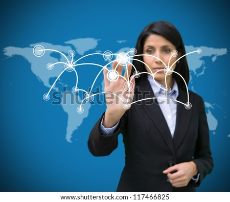 Buinesswoman pressing on holographic screen with connecting lines on world map background