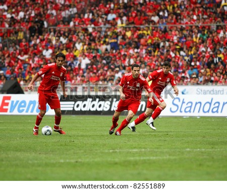 BUKIT JALIL - JULY 16 : Alberto Aquilani with the ball, leads Liverpool FC's attack against Malaysia in this game at the National Stadium on July 16, 2011, Bukit Jalil, Malaysia. Liverpool won 6-3. - stock photo