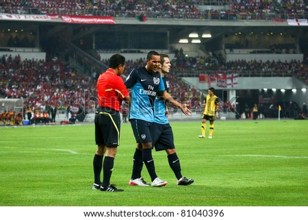 BUKIT JALIL, MALAYSIA - JULY 13: Arsenal's Theo Walcott pleads innocence to the referee on July 13, 2011 in Stadium Bukit Jalil, Malaysia. English league team Arsenal is on an Asia Tour.
