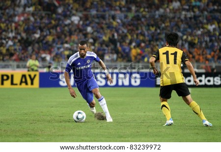BUKIT JALIL, MALAYSIA - JULY 21: Chelsea's Ashley Cole (blue) tries to turn the Malaysian defender in this match at the National Stadium on July 21, 2011 in Bukit Jalil, Malaysia. Chelsea won 1-0.