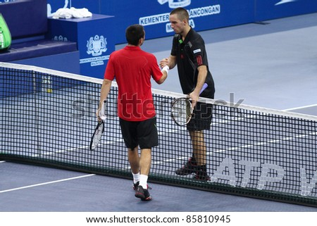 BUKIT JALIL, MALAYSIA - OCT 01: Serbia's Viktor Troicki congratulates Cyprus' Marco Baghdatis for his Malaysian Open semi-final win on October 01, 2011 in Putra Stadium, Bukit Jalil, Malaysia.