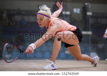 BUKIT JALIL, MALAYSIA - SEPTEMBER 11: Lisa Aitken stretches to return a drop at the CIMB Malaysian Open Squash Championship 2012 on September 11, 2012 at the National Squash Centre, Malaysia.