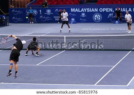 BUKIT JALIL - OCT 01: Eric Butorac (cap)serves in this Malaysian Open semi-final doubles game partnering J-J Rojer against Lipsky/Ram on October 01, 2011 in Putra Stadium, Bukit Jalil, Malaysia.