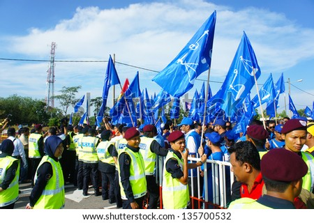 BUKIT KATIL, MALACCA, MALAYSIA-APR 20: Crowd of people show big support to Barisan Nasional political party candidate Apr 20, 2013 in Bukit Katil. An election will be held on May 5, 2013 - stock photo