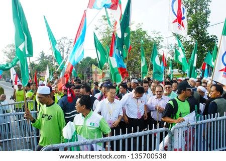 BUKIT KATIL, MALACCA, MALAYSIA-APR 20: Crowd of people show big support to Pakatan Rakyat political party candidate Apr 20, 2013 in Bukit Katil. An election will be held on May 5, 2013 - stock photo