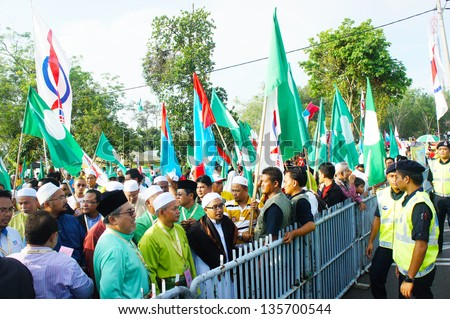 BUKIT KATIL, MALACCA, MALAYSIA-APR 20: Crowd of people show big support to Pakatan Rakyat political party candidate Apr 20, 2013 in Bukit Katil. An election will be held on May 5, 2013