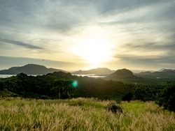 Bukit Tengkorak Archaeological Heritage Site at sunset with the grass blowing in the wind in Semporna, Borneo