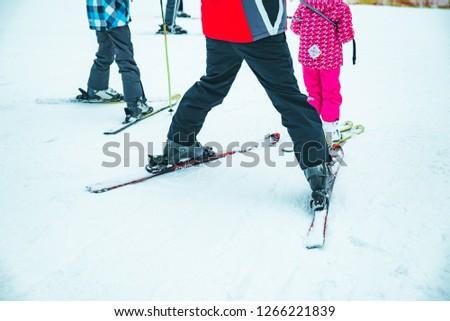 BUKOVEL, UKRAINE - December 9, 2018: legs of skiing people close up. winter vacation #1266221839