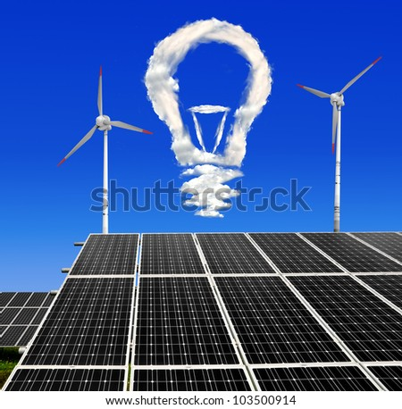 Bulb from clouds above the solar energy panels with wind turbines