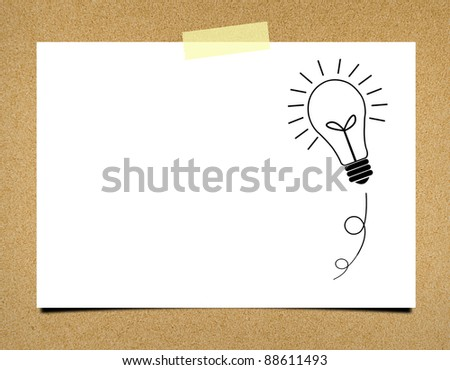 Bulb idea note paper on board background