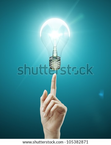 bulb light on women fingertip