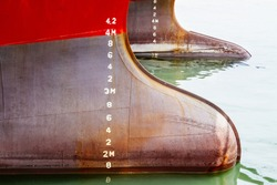 Bulbous bow of two ships with draft measurement