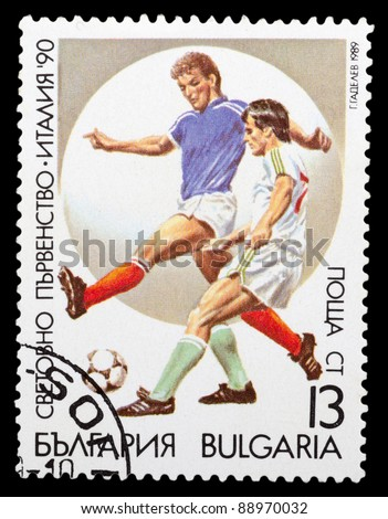 BULGARIA - CIRCA 1990: a stamp printed by Bulgaria shows football players. World football cup in Italy, series, circa 1990