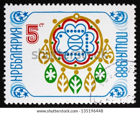 BULGARIA - CIRCA 1987: a stamp printed in the Bulgaria shows New Year 1988, Sofia Stamp Exhibition Emblem with Folklore Patterns, circa 1987 - stock photo