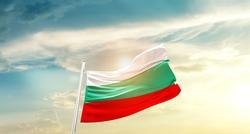 Bulgaria national flag waving in beautiful clouds.