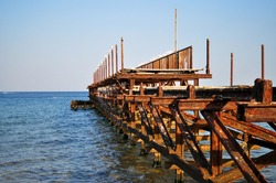 Bulgaria, Sunny Beach, Burgas region. Black sea and white gulls. Rusty bridge by the sea, pier.