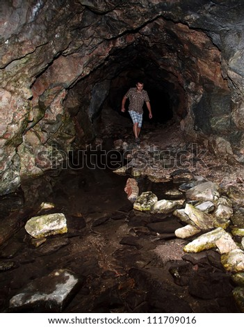 bulgarian cave in Rila mountain with hiker in the deep