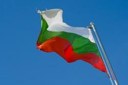 bulgarian flag on a pole against blue sky