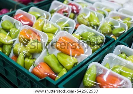 Bulgarian pepper in a box on a shelf in a supermarket #542582539