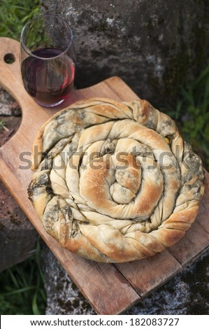 Bulgarian rolled pastry with green plants