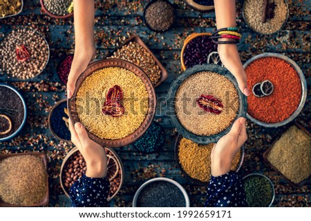Bulgur wheat at the hands of two women in the bowl. Stok fotoğraf ©